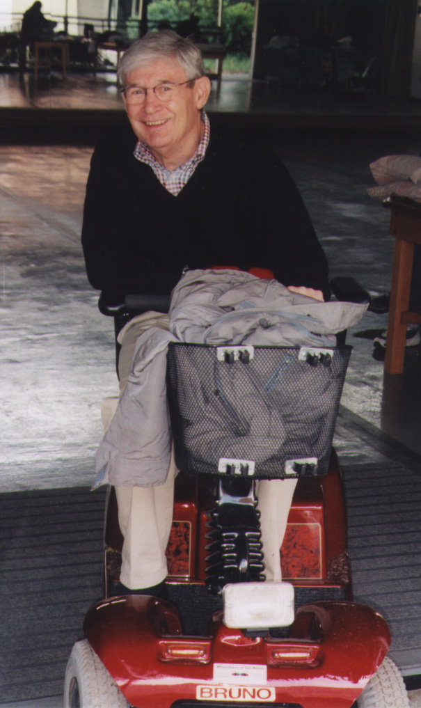 Dr. H. Phil Gross on his three-wheel scooter.