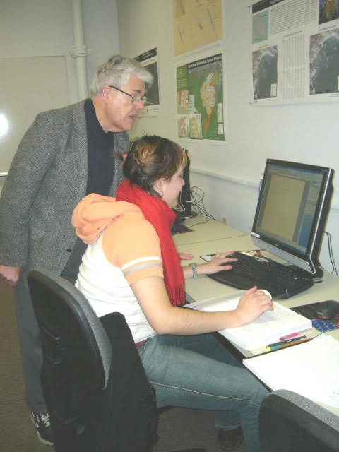 Instructor and student working on computer